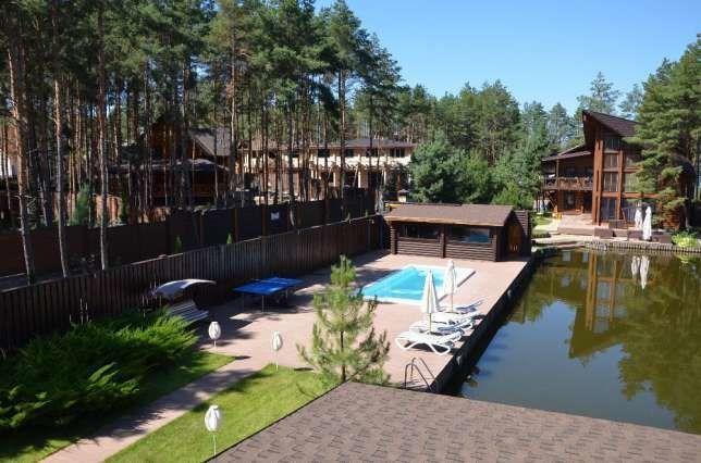Продам жилой дом-сруб в сосновом лесу на берегу озера