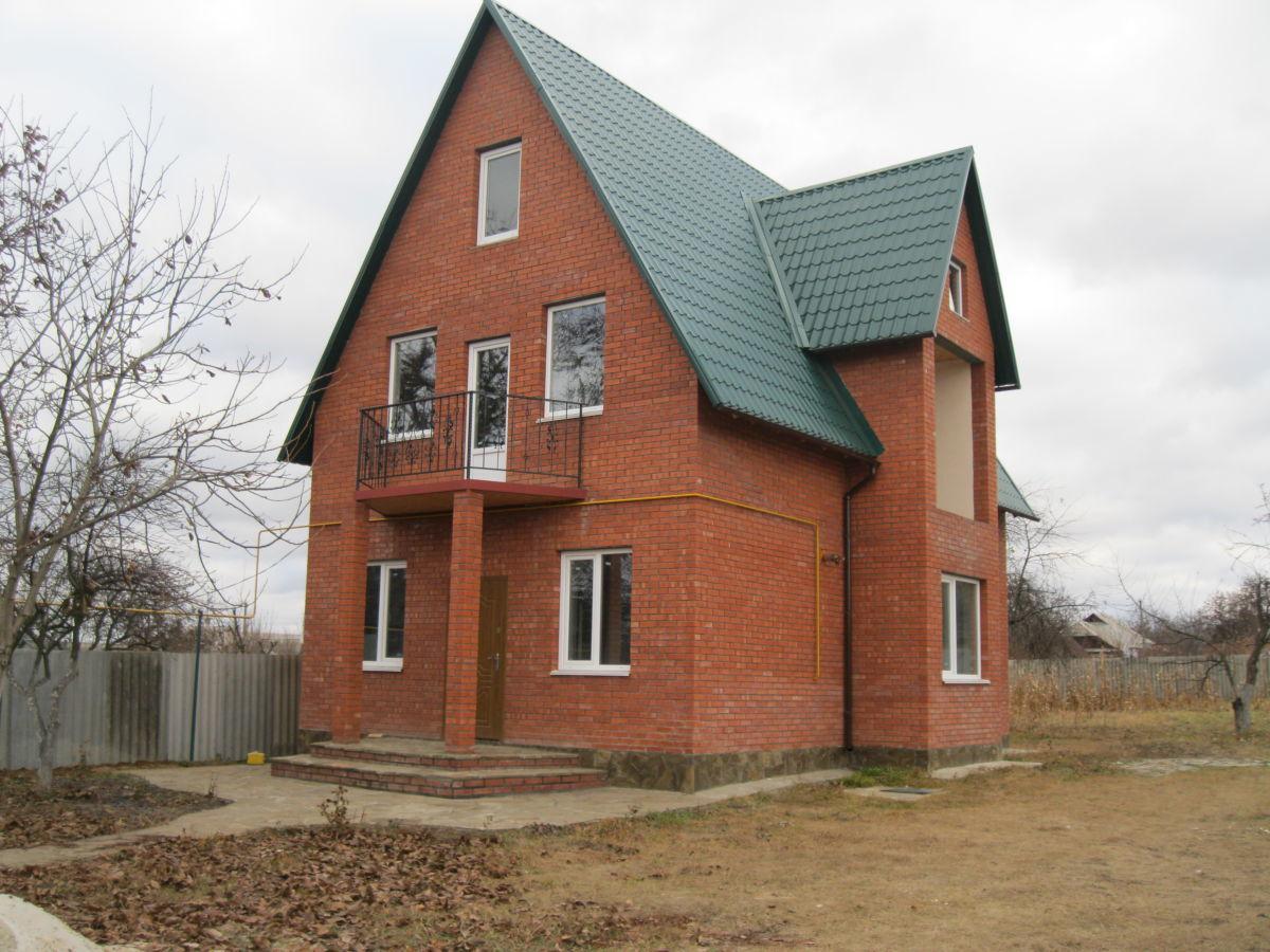 Продам! Новый дом 2014 г. постройки 3 уровня г. Люботин 160 м. кв.