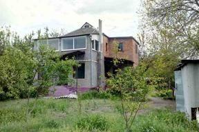 Продам 2-х этажный дом в Обуховке  в районе элитных застроек!