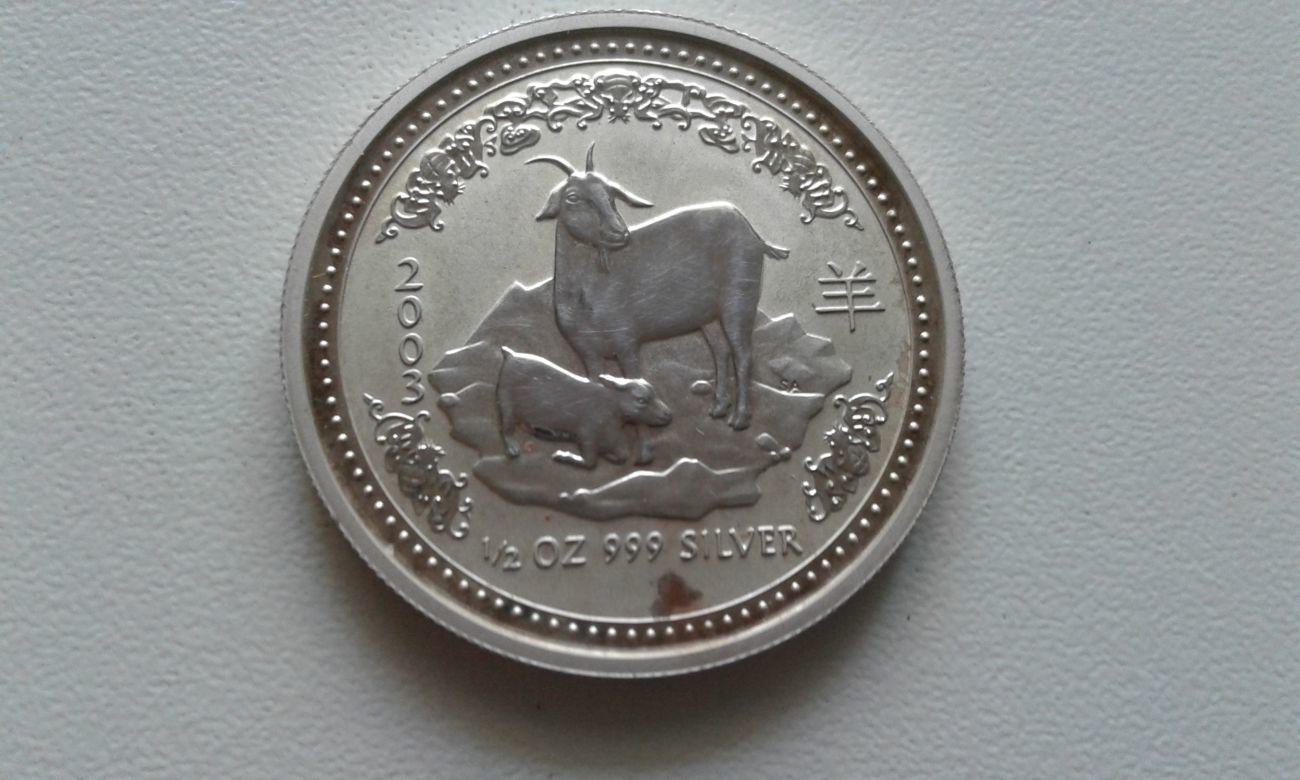 Серебряная монета 2003 года 5 ли