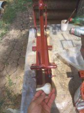 Обрезка чеснока. Аппарат для обрезки ботвы и корней чеснока