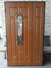 Входные двери с элементами ковки для частного дома винорит 1200