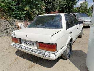 Автомобиль Mazda 323 BF 4
