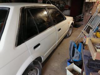 Автомобиль Mazda 323 BF 8