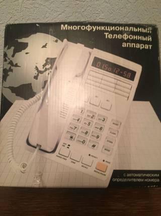 Телефон Casio  стационарный 4
