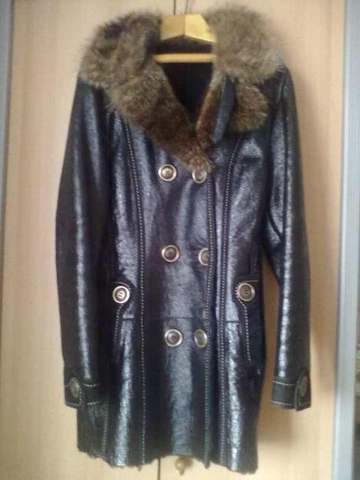 Пальто женское,кожаное,на натуральном меху.