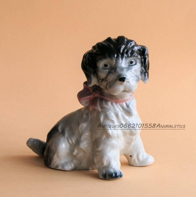 Фарфоровая статуэтка фарфор LIPPELSDORF щенок с бантом