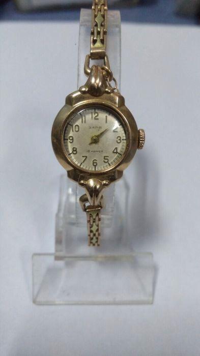 Стоимость позолоченные заря часы стоимость cornavin часы