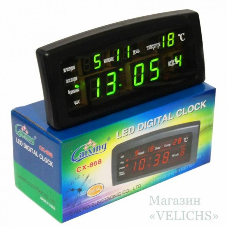 Электронные часы с календарем, термометром и будильниками