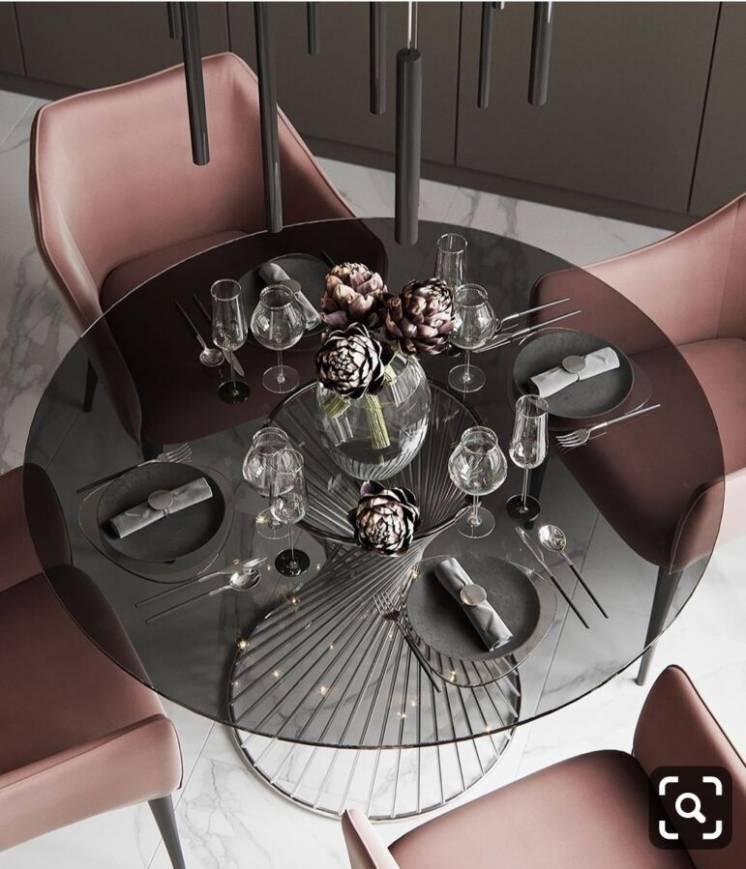 Стеклянный столик модерн из нержавеющей стали и стекла.