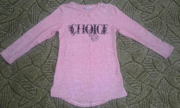В наличии новый свитер-туника на девочку 9-10 лет.