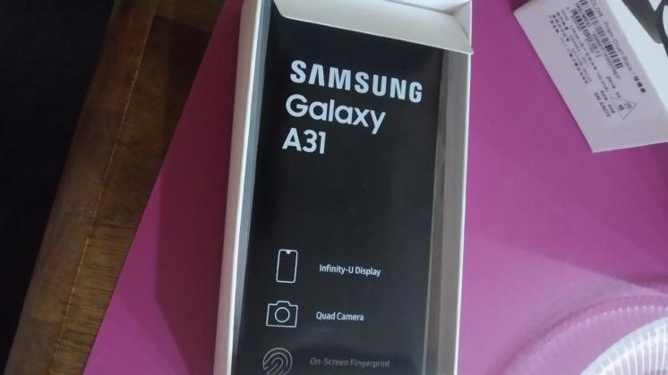 продам новый Samsung a31 4/64,цвет красный. гарантия 12 месяцев