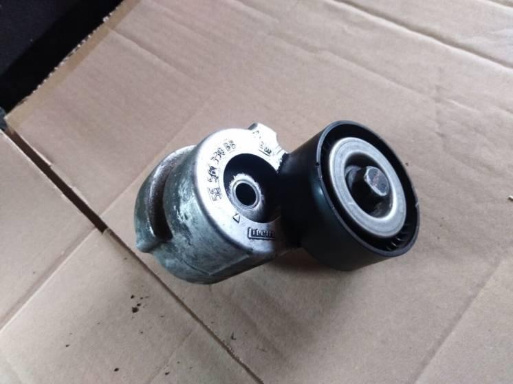 Ролик натяжной механизм ремня 1.9 Opel Astra Zafira 55561330