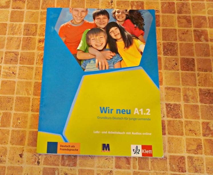 Книга для изучения немецкого -Wir neu A 1.2