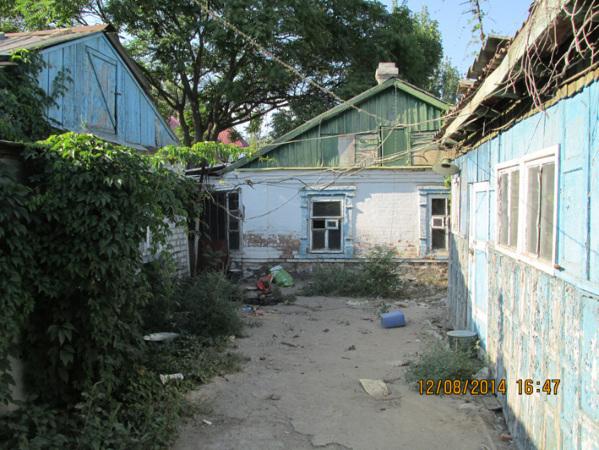 Участок земли с домом под снос в центре