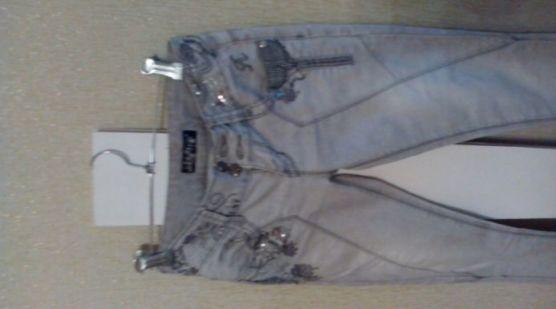 джинсы и брюки женские
