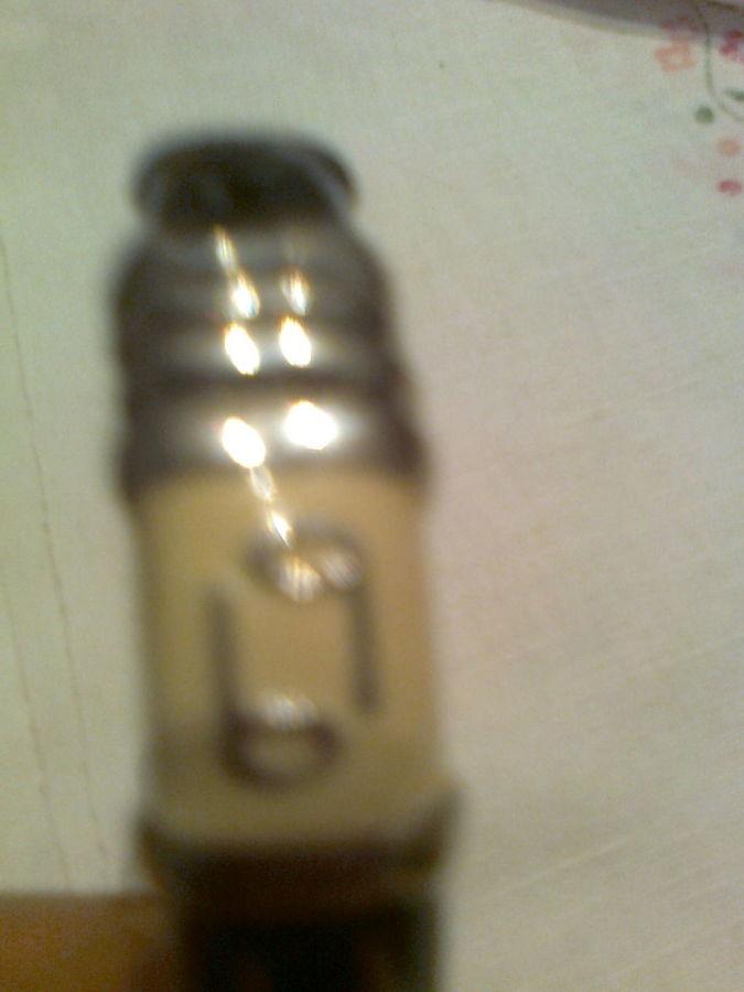 Фото - Оригинальный металлический  браслет , на черном и кофейном фоне-буквы
