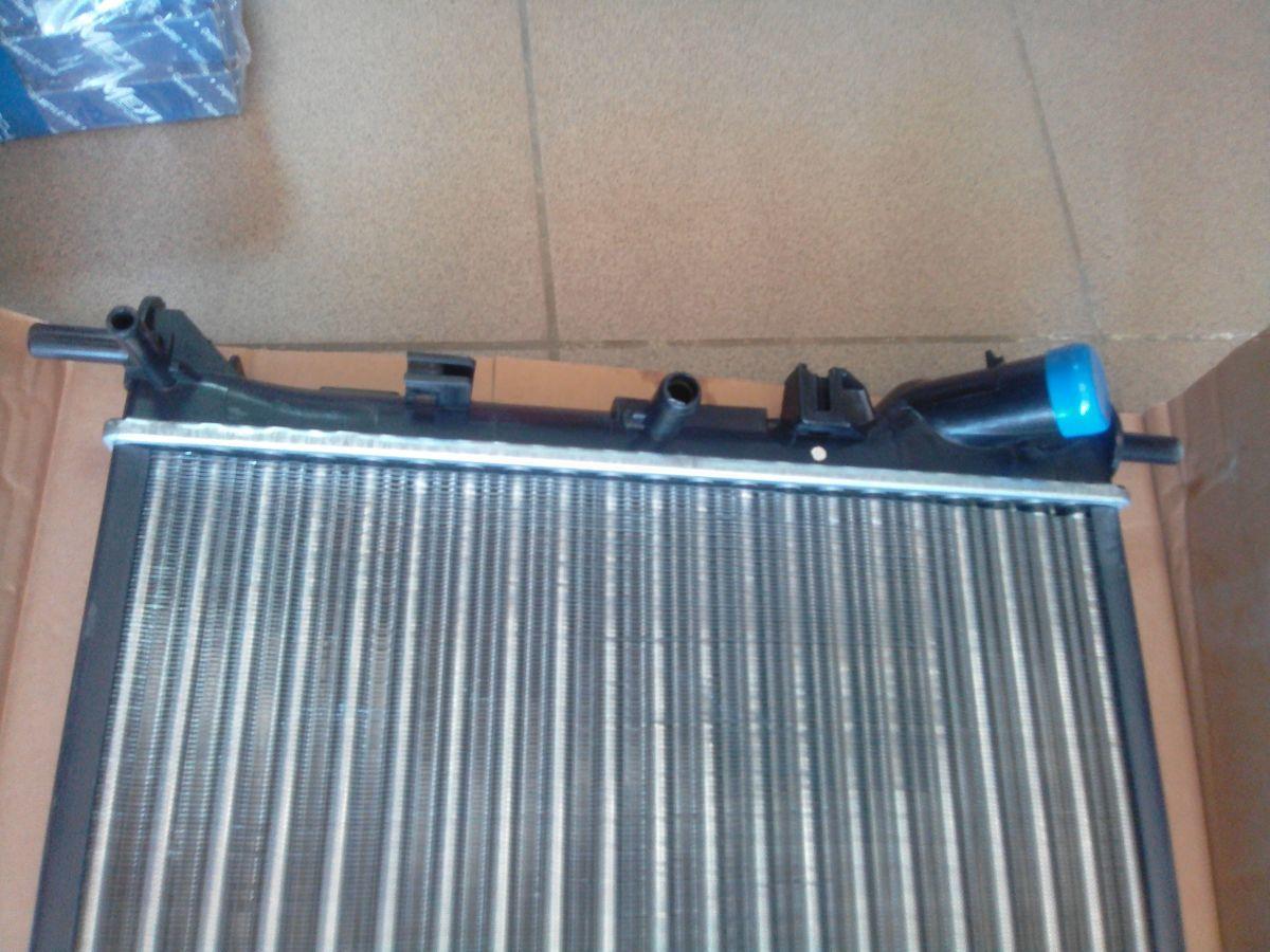 Фото - Радиатор охлаждения Ford Connect